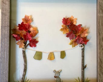 Pebble Art clothes line of Sea Glass and pebble puppy.