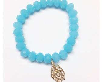 Aqua Blue Faceted Crystal Bead Bracelet with Gold Peacock Feather Charm