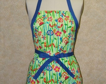 Snails in the grass apron pocket kids childs cotton chef gardening crafting baking cooking art cover up blue tie worm lady bug flower grass
