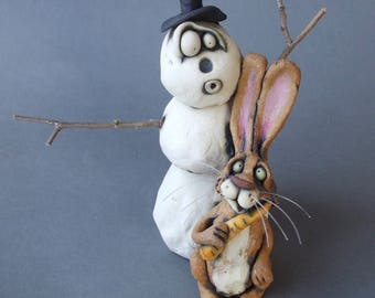 Snowman with Missing Nose and Bunny with Carrot Whimsical Sculpture