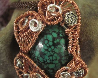 Copper and silver wire woven turquoise pendant