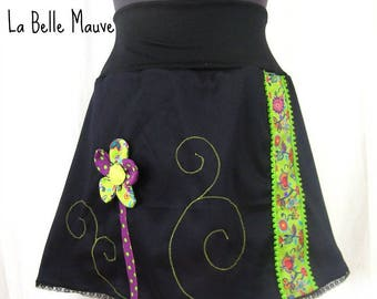 Green and black skirt with flower