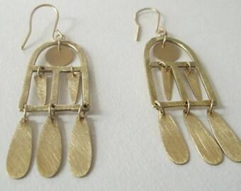 kinetic brass window earrings