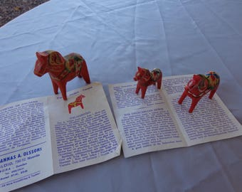 Vintage Three Dalecarlian Horses - 3 piece set and paperwork explaining horse.  Made in Mora Sweden  Vintage red horses