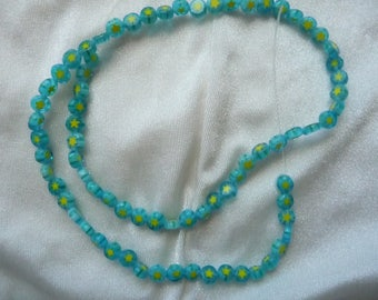 Bead, millefiori glass, 5mm blue flat coin with flower design, sold per 16 inch strand. There are 75 beads on the strand.