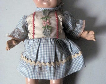 Vintage composition doll in need of TLC