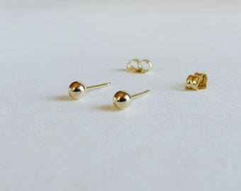 Tiny gold studs. Solid 14k gold ball post earrings.