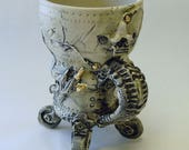 Hybrid Dystopia Mug.  On wheels.  Detailed in 22k gold.