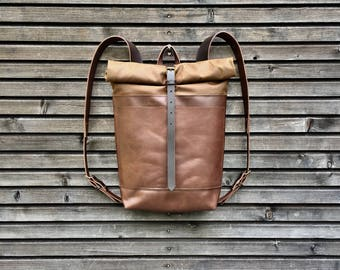 Leather backpack with waxed canvas  roll to close top and double outside pocket
