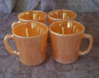 Vintage group of four peach luster D handle mugs.  C1-736-6