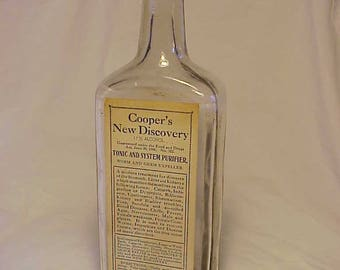 c1906 Cooper's New Discovery The Cooper Medicine Co. Dayton, Ohio, Cork Top Clear Blown Glass Patent Medicine bottle with Paper Label