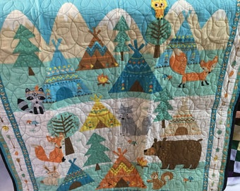 baby quilt from Northcott panel 34 x 42.