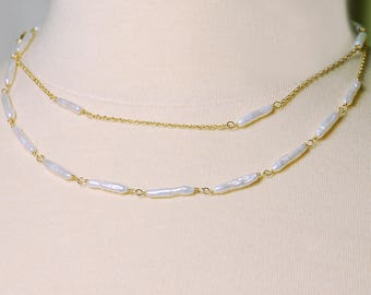 Long Stick Pearl Necklace by Agusha.  White Pearl Necklace
