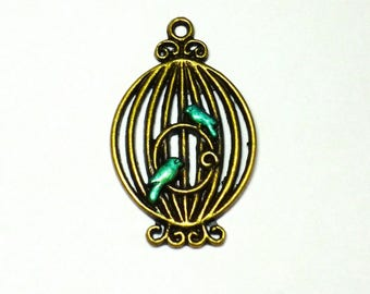 A bronze bird charm / cage painted handmade