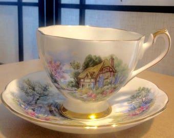 Vintage teacup and saucer set, English white bone china, gold edge, English cottage scene