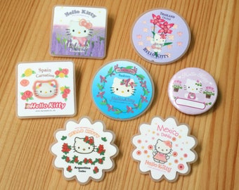 7 Hello Kitty pin buttons (rummage sale)