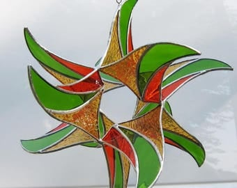 3D Stained glass suncatcher 3 dimensional window hanging, vibrant mint green, golden amber and orange colors.  12 x 12 x 10 inches.