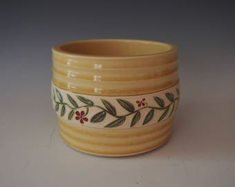 Wheel thrown yellow planter with floral vine