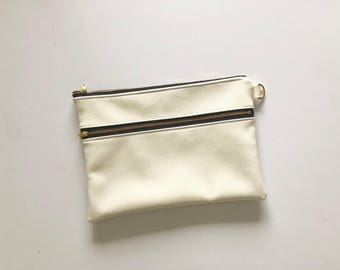 Shimmery white faux leather souble zip clutch