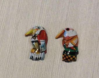 Pair tin litho teacher bird pins 1960s made in Japan