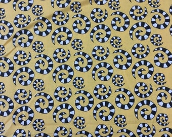 "In the beginning ""Happy "" black and white swirls on yellow fabric by the Half Metre"