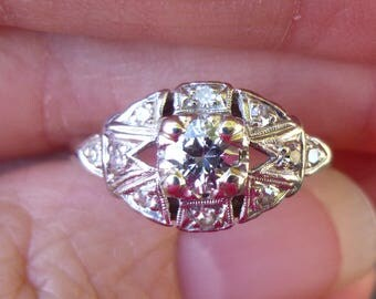 Art Deco  Platinum center diamond with 10 small diamonds around the main diamond  Engagment Ring 40 points total weight