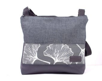 Handmade cross body bag. Grey upholstery fabric, black vinyl and featuring ginkgo fabric. Large.