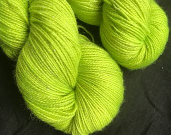 Radioactive hand dyed sparkly sock yarn