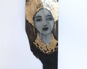 Ebony and gold leaf wood painting on an icon spirit