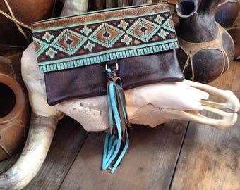 Aztec print embossed leather tassel clutch