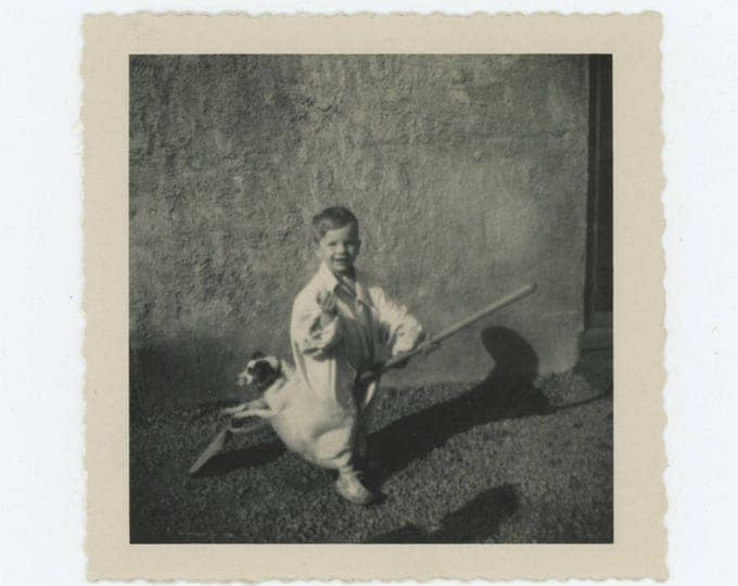 Boy & Dog Ride Shovel, 1950s: Vintage Snapshot Photo (75584)