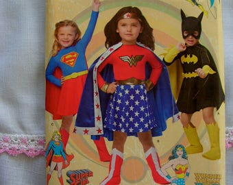 Batgirl Super Girl Wonder Woman Costumes Child Sizes 3 4 5 6 7 8 Simplicity 1035 uncut factory folded costume sewing pattern