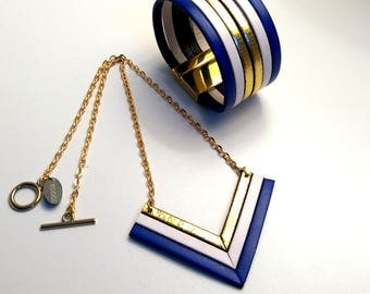 Set with blue, white and gold leather