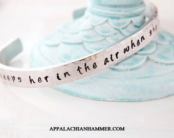 "Love keeps her in the air when she oughta fall down Skinny 1/4"" Aluminum Cuff Bracelet"