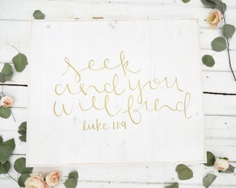 seek and you will find gold and white rustic wood sign