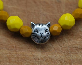 Br-37  Cat-bracelet, beaded stretch bracelet, faceted firepolished Czech yellow and ochre glass beads, silver cat charm.