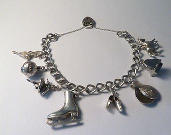 Vintage jewellery / jewelry hobby themed pastime themed sterling silver charm bracelets 1974 fully hallmarked