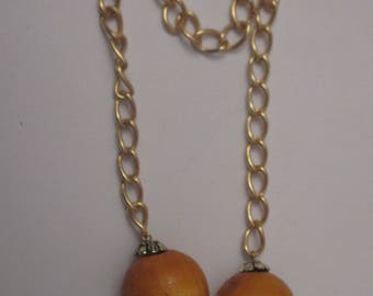 2 large beads made of wood with gold chain and bead caps (PB1-5)