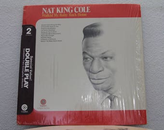 """Nat King Cole - """"Walkin' My Baby Back Home / A Blossom Fell"""" vinyl records, 2 LPs"""