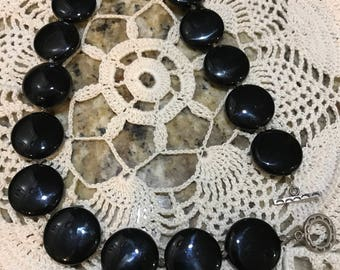 Vintage vixen black glass bead/disc necklace. Made well. Mexican silver?