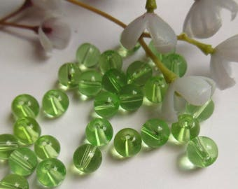 set of 10 round green glass beads