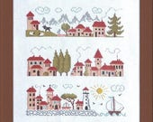 Between Sea and Mountain – counted cross stitch chart to work in 14 colours of DMC thread.  Houses, Mountains and sea motifs are used.