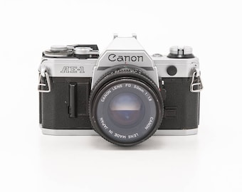 Canon AE-1 35mm Film Camera with 50mm Prime FD 1.8 Lens and Visitor Flash  - Working Condition
