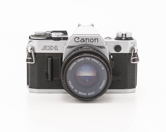 Featured listing image: Canon AE-1 35mm Film Camera with 50mm Prime FD 1.8 Lens and Visitor Flash  - Working Condition