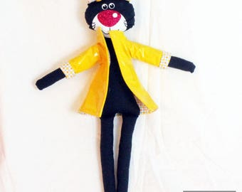 Black cat doll with yellow wax