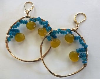 Lemon Drops Earrings are gold organic hoops draped with electric blue Apatites and lemony Chalcedony brios to swing from gold leverbacks.
