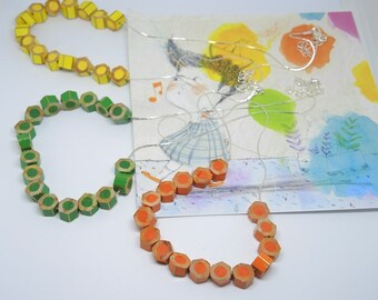Choker necklace with small segments of Orange, yellow or green colored pencils