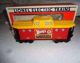 Lionel electric trains, 027 or O gauge ,lighted caboose,Wendys Hamburger resturant