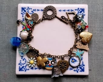 Blue and gold charms Cha cha bracelet Locket charm bracelet Starfish and shell charms Flowers bracelet Charms bracelet