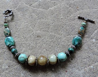 Bracelet in silver and gems: aquamarine, turquoise...